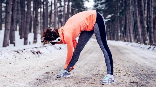 Shutterstock: woman stretching before a run