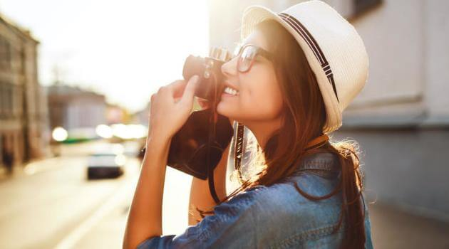 Shutterstock: woman taking a picture