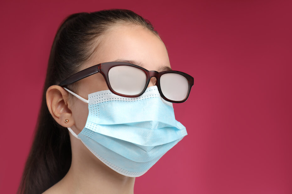 Shutterstock: Woman wearing mask and fogged glasses