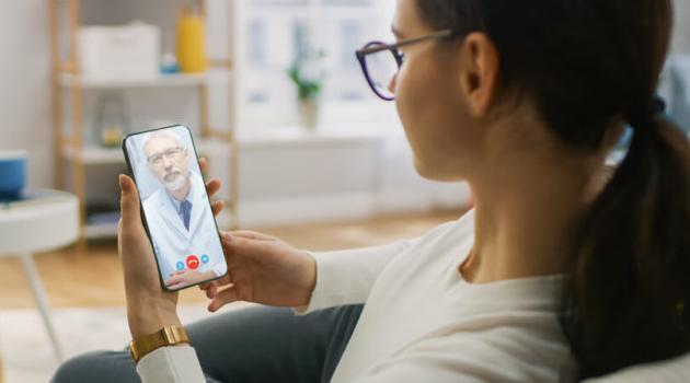 Shutterstock: girl talking to doctor on FaceTime
