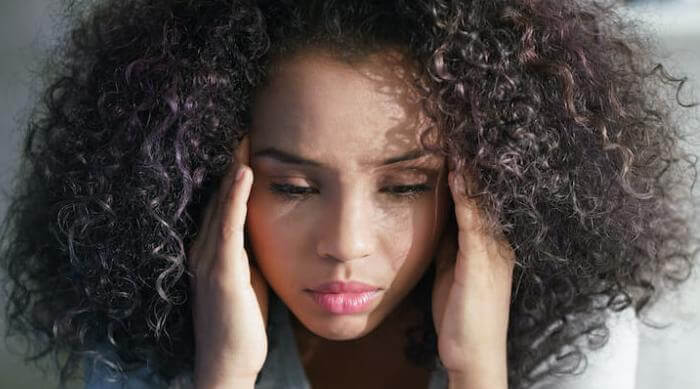 Shutterstock: girl with headache