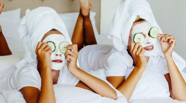 Shutterstock: two girls doing at-home facials