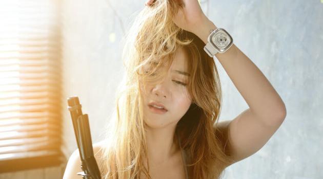 Shutterstock: woman straightening damaged hair