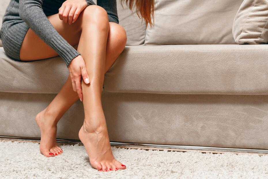 Shutterstock: Woman massaging legs
