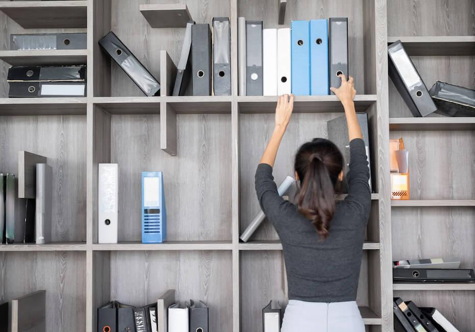 Shutterstock: Woman organizing clean shelf space