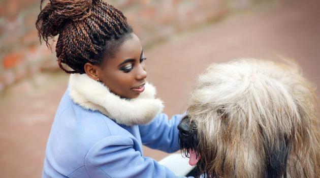 shutterstock-woman-petting-dog-011721-e1610917825516-articleH-011721