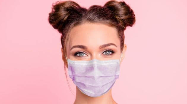 Shutterstock: woman wearing a face mask and space buns