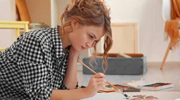 Shutterstock: woman painting in her studio