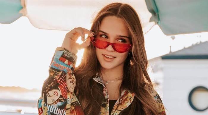 Amalie Anstett staring off sunglasses