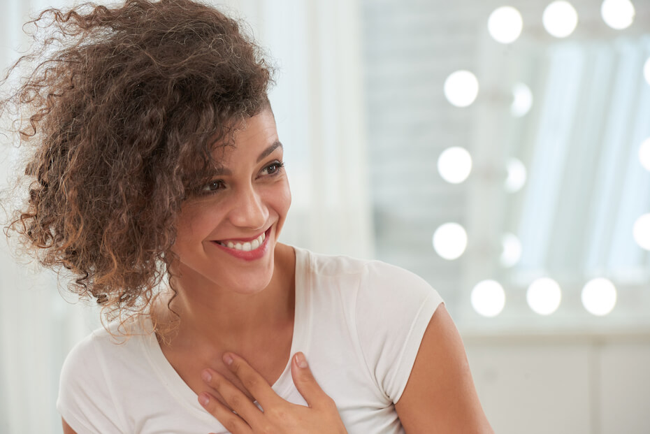 Shutterstock: Happy pretty young woman taking compliment