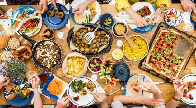 Shutterstock: plant-based food shared by friends