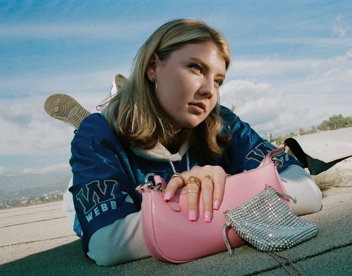 Tanner Deutsch: Dasha posing with pink nails and bag