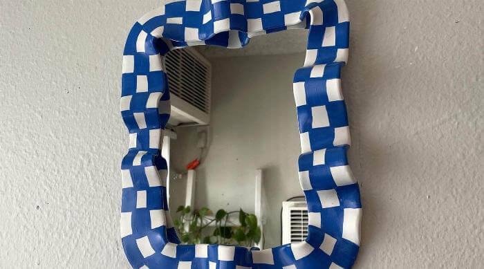 blue and white checker clay mirror