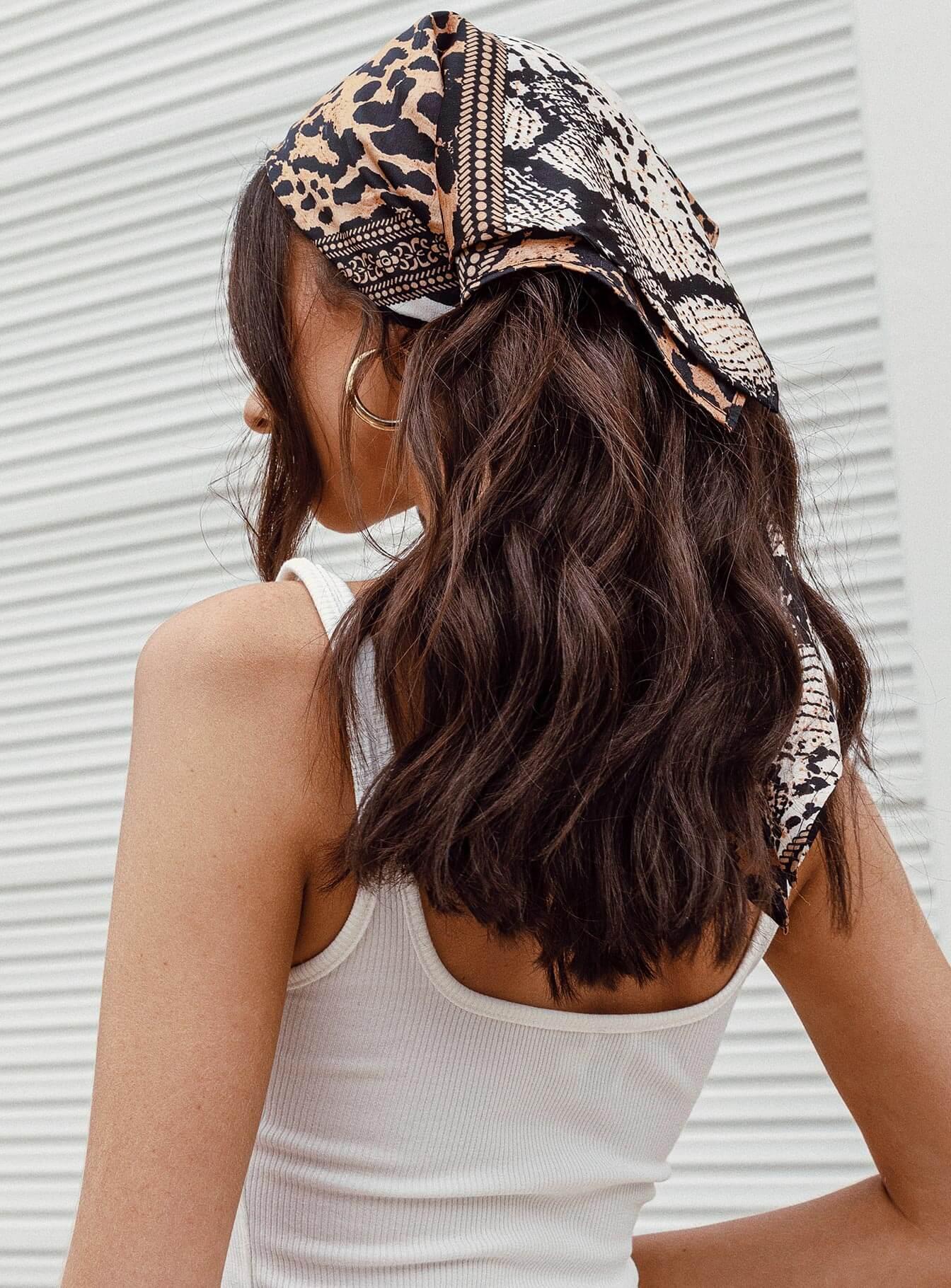 a girl wearing princess polly hair scarf