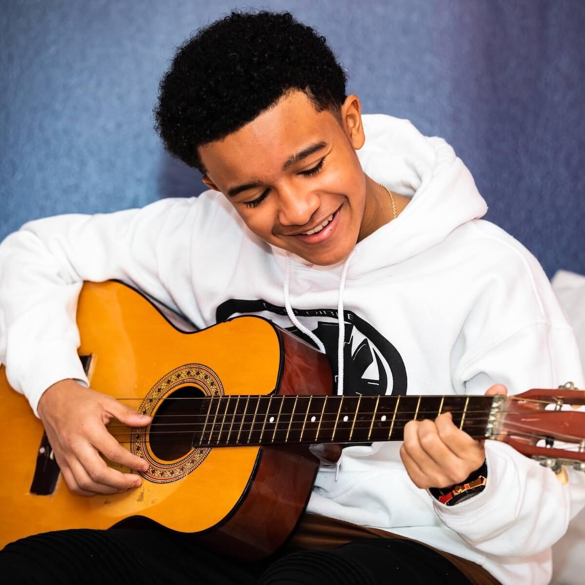 Cameron J Wright playing guitar