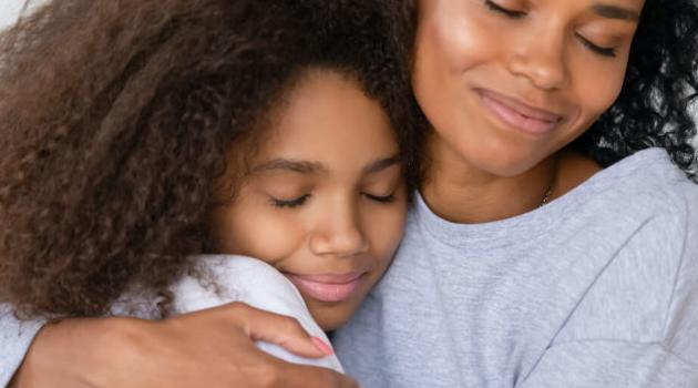 Shutterstock: daughter hugging mom