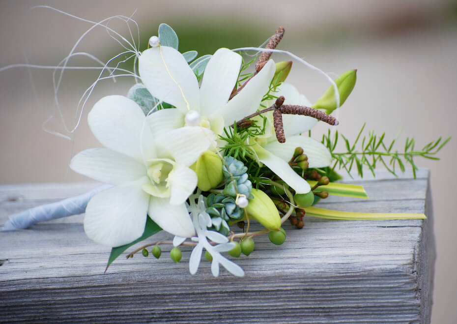 shutterstock: Ladies Floral Corsage of White Dendrobium Orchids and Decorative Materials. Wedding Flowers.