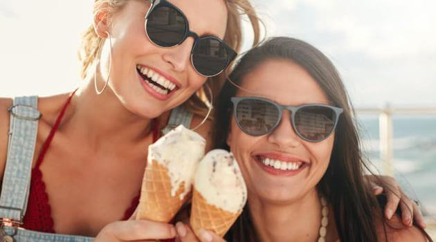Shutterstock: two friends eating ice cream