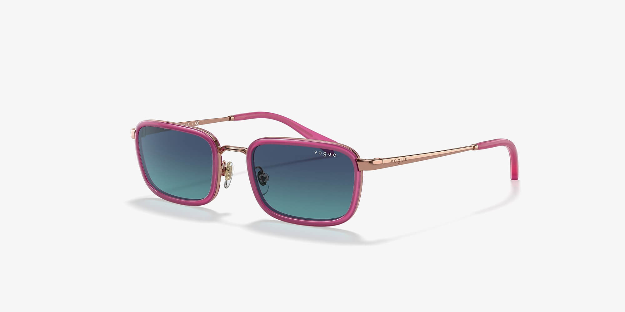 vintage pink vogue sunglasses on a white background