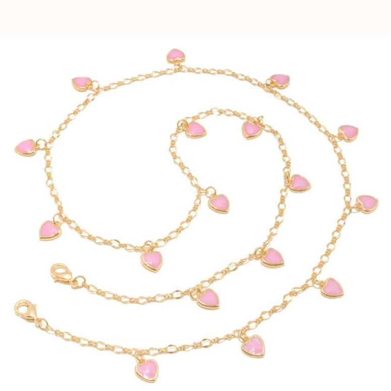 a gold chain with pink hearts on a white background