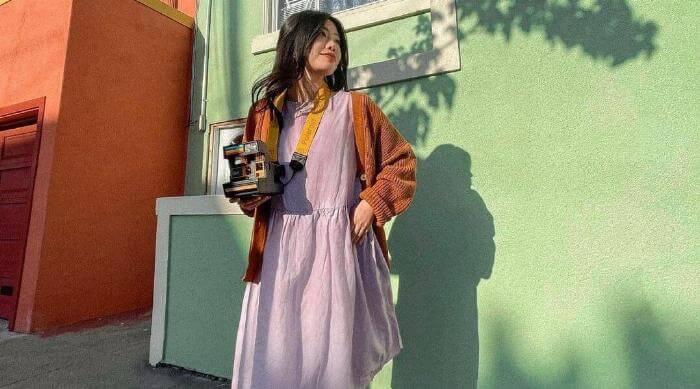 Instagram @thredup woman in vintage dress with camera