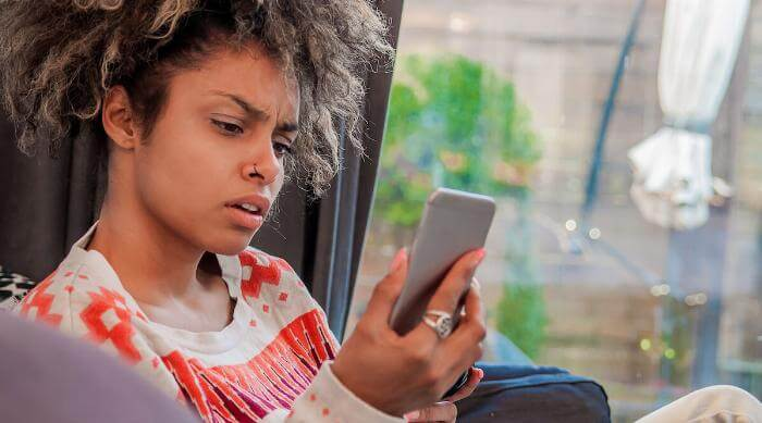 Shutterstock: woman with worried expression on the phone. stressed shocked young woman, talking on cellular, having unpleasant conversation receiving bad news. Human emotions, facial expression