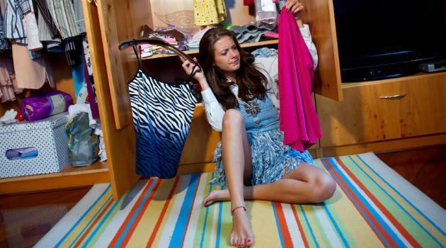 teen-in-closet-looking-at-clothes-articleH-050521