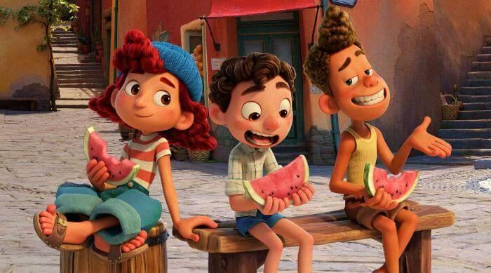 Luca: Luca, Giuliana and Alberto eating watermelon in town