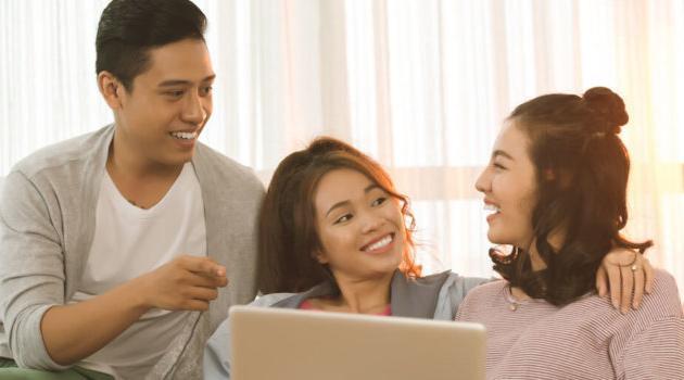 Shutterstock: three friends watching movie on laptop