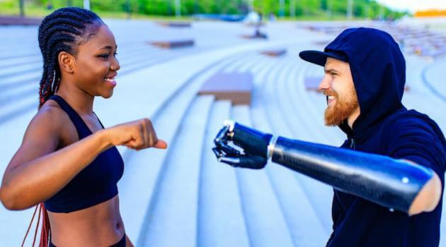 Shutterstock: two friends fist bumping outside