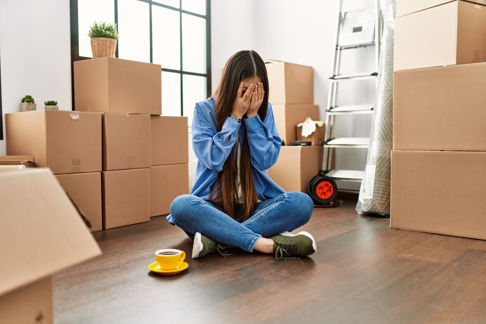 girl moving packing house boxes