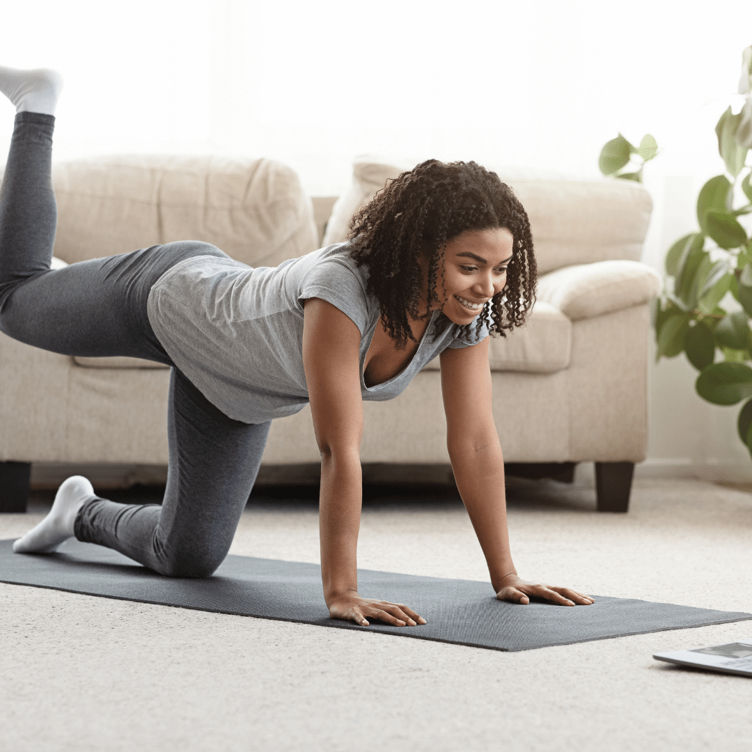 Shutterstock: Woman working out on yoga mat at home