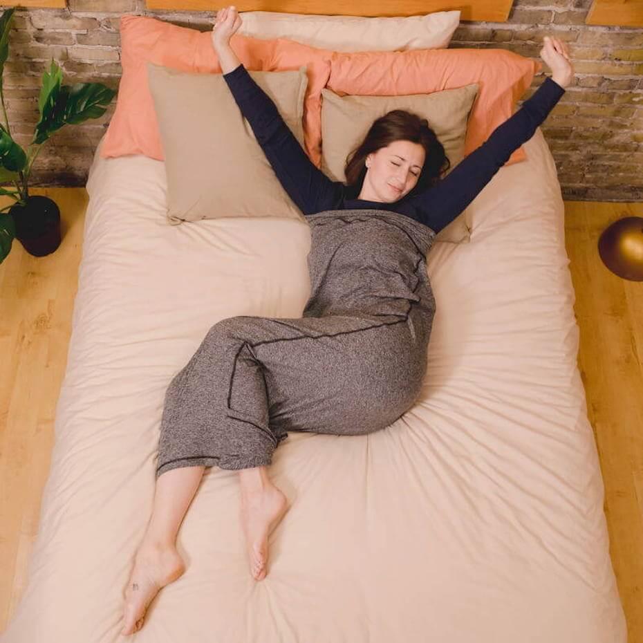 Hug sleep woman in bed waking peacefully