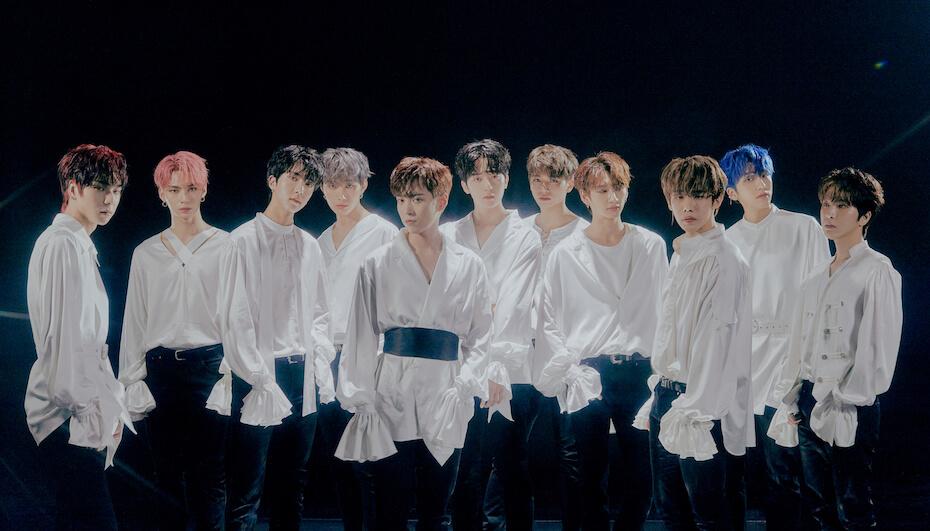 Omega X white shirts group photo