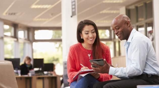 Shutterstock: advisor helping student in student services