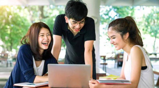 Shutterstock: three friends studying together outside