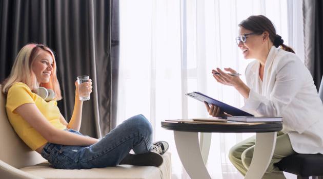 Shutterstock: two women talking across table