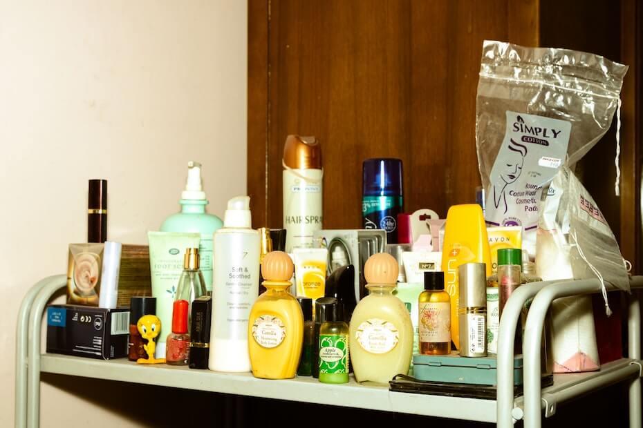 Unsplash: Beauty supply clutter on table