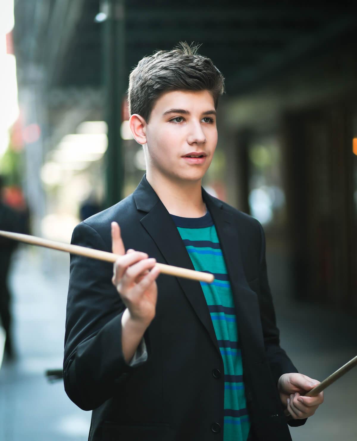 Joshua Turchin with drumsticks