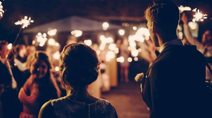 Unsplash: Andreas ronningen couple walking into party