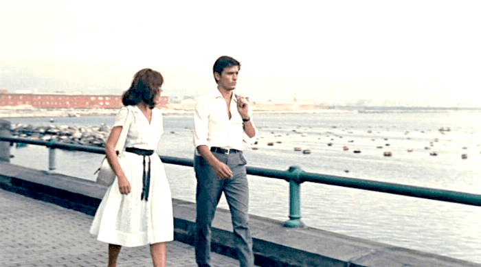 man and woman guy and girl on walk beach