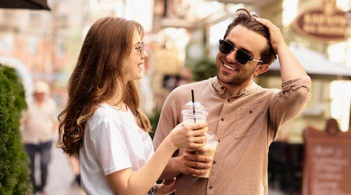 Shutterstock: young beautiful couple have a fun and walking on city streets and drinking coffee