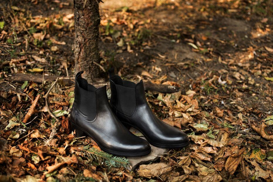 A pair of black chelsea boots on the ground
