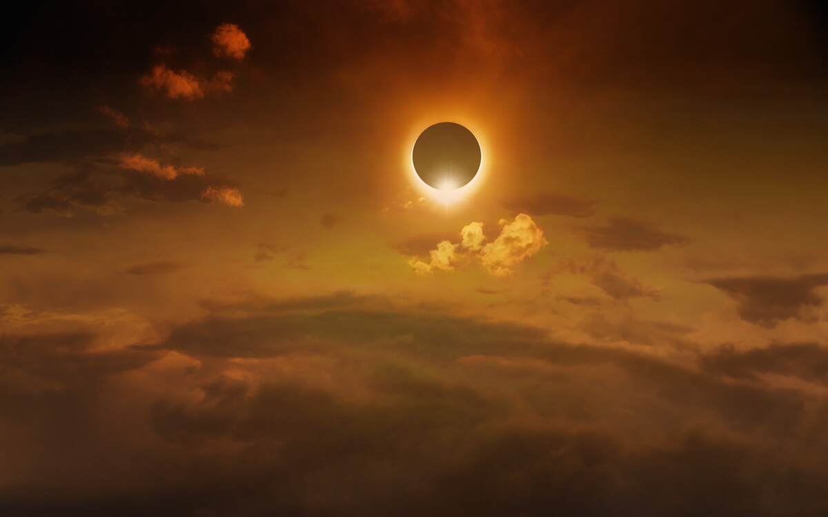 Shutterstock: Amazing scientific background - total solar eclipse in dark red glowing sky, mysterious natural phenomenon when Moon passes between planet Earth and Sun