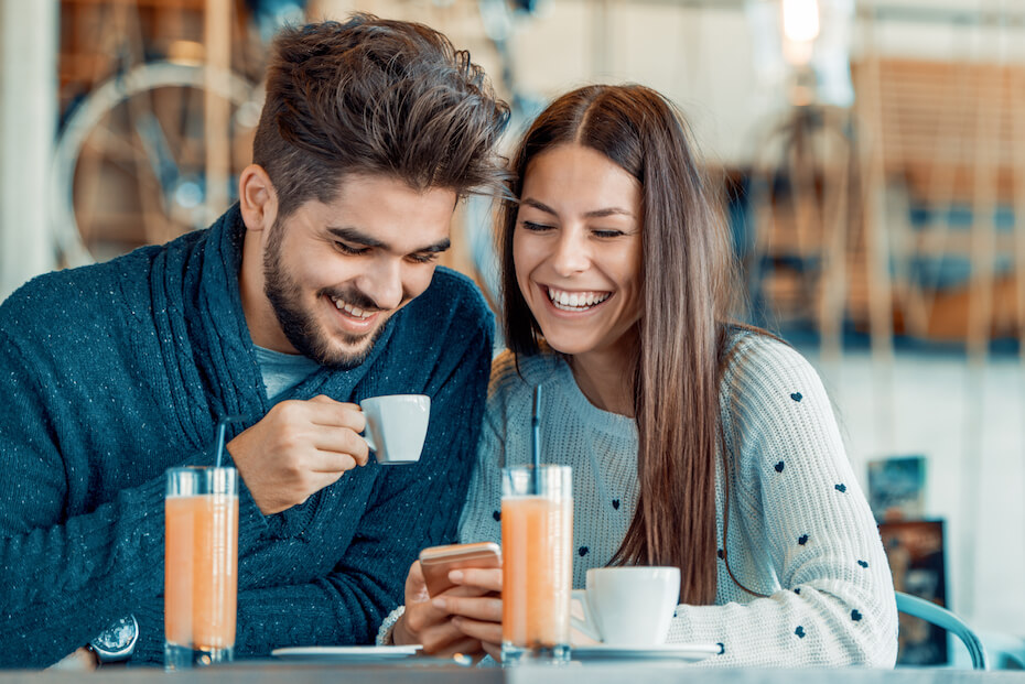 Shutterstock: Happy couple enjoying a coffee at the coffee shop.
