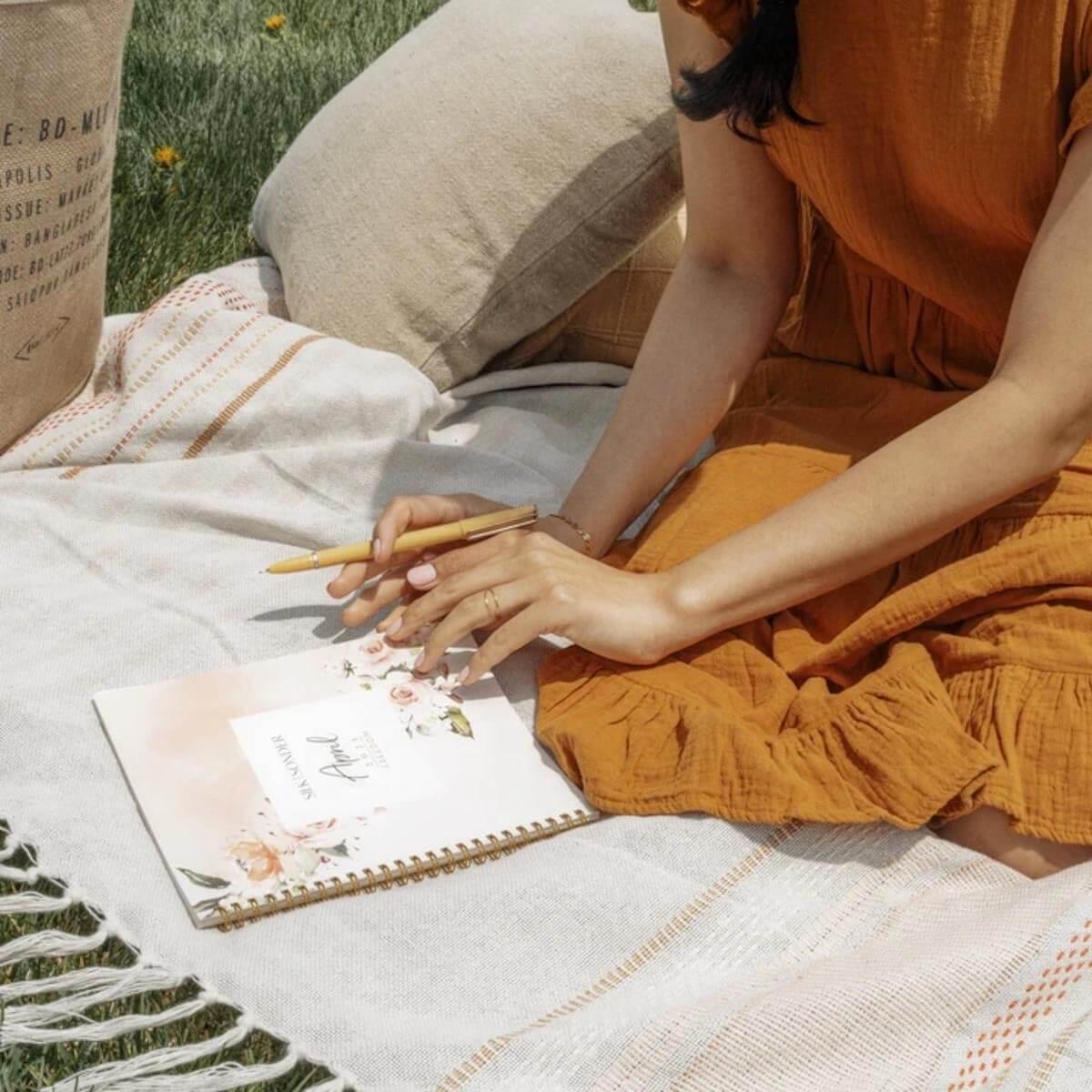 Silk + Sonder woman writing in journal