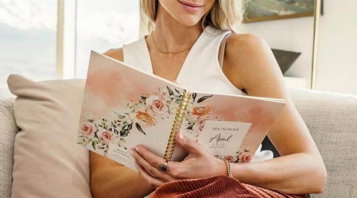 Silk + Sonder woman writing in april journal